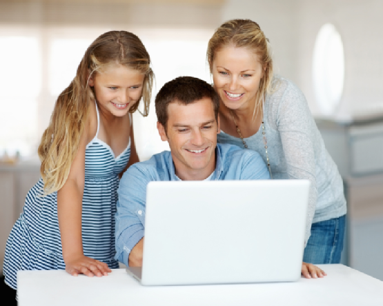 Man using a laptop with his family