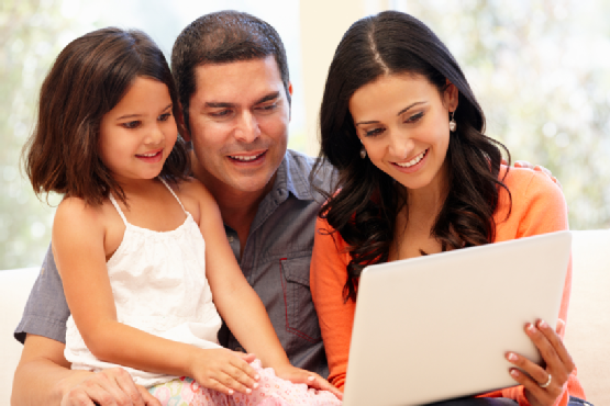 Hispanic family with laptop at home